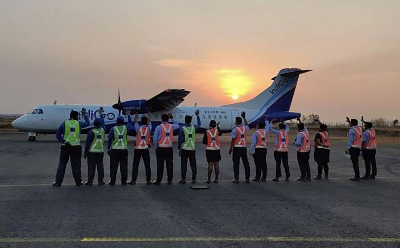 Acknowledging the role played by regional aircraft in humanitarian efforts during the COVID-19 pandemic crisis, IndiGo's ground crew wave to passengers as ATR 72-600 (MSN 1529) lands at sunset